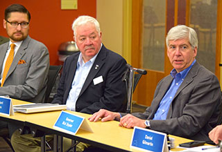 League Vice President Nathan Triplett and President Dick Bolen listen to Governor Snyder discuss the state's road funding ballot initiative. The board voted to support the effort going before voters May 5.