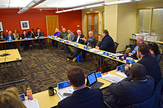 Members of the Michigan Municipal League Board of Trustees listen to Governor Snyder discuss the state's road funding ballot initiative. The board voted to unanimously support the effort going before voters May 5.