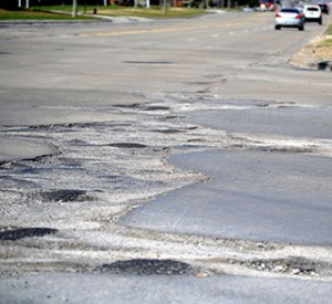 A plethora of potholes on a Michigan road.