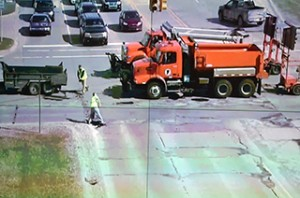 A road crew fills potholes in Macomb County.