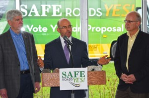Sterling Heights City Manager and MML board member Mark Vanderpool speaks at a Proposal 1 Safe Roads Yes! tour bus stop in Romeo. The League appreciates all the support it has received from members on Proposal 1.