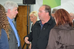 League members - Lapeer City Manager Dale Kerbyson and Lapeer City Commissioner and MML Board member Catherine Bostick-Tullius - talk with Governor Snyder at a Proposal 1 bus tour stop near Davison.
