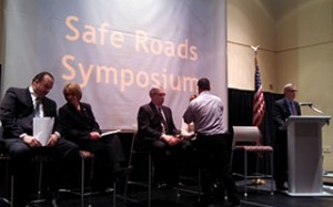 Panelists get ready for the symposium.