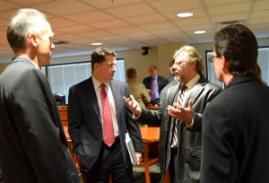 Auburn Hills officials talk with State Rep. Jim Townsend following a House Tax Policy Hearing on the Dark Stores issue Dec. 9, 2015.