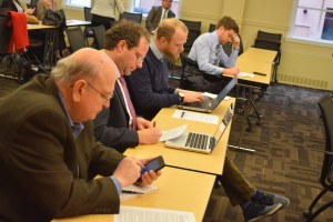 Reporters cover the press conference Tuesday at the League's office in Lansing.