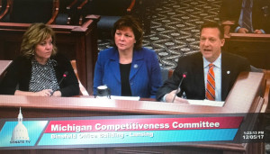 The League's Chris Hackbarth, right, testifies about the proposed OPEB legislation with officials from the Michigan Association of Counties and Michigan Townships Association.